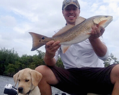 Dr. Burke fishing with his puppy