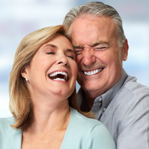 Middle-aged couple embracing each other and smiling